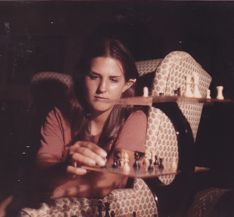 A staged picture of Liz Danforth (teenaged) with Spock-ears and eyebrows, playing 3D chess.