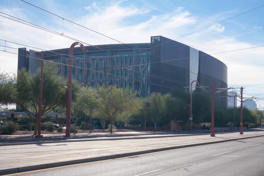A street-side photograph of an industrial-looking building, the Burton Barr Central Library in Phoenix Arizona.