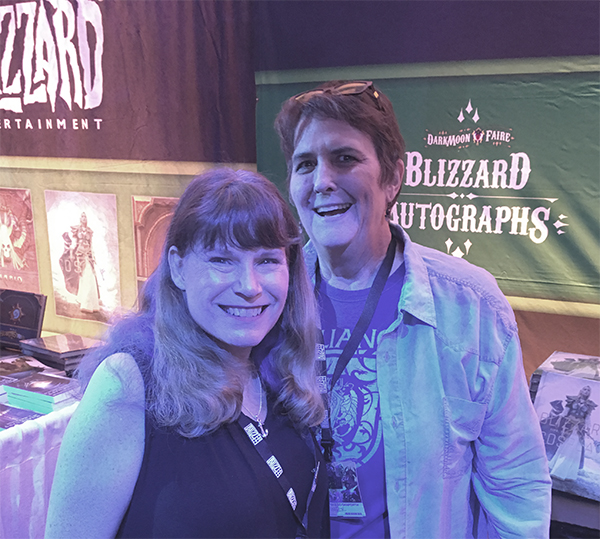Photograph of Christie Golden and Liz Danforth at Blizzard's autograph booth, November 2018.