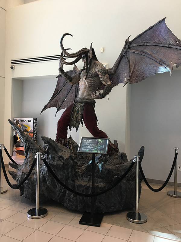 A twice-life-size statue of the character Illidan from World of Warcraft, a bat-winged and massively-horned night-elf character. The sculpture appears on the campus of Blizzard Entertainment.