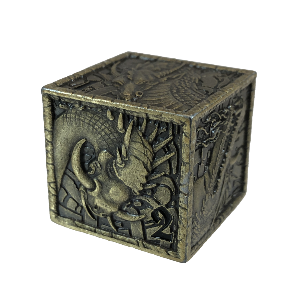 A big metal dice with pictures of dragon heads on all sides.